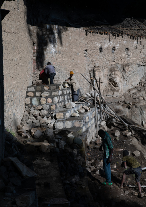 Workers repairing nakuto lab rock church, Amhara Region, Lalibela, Ethiopia