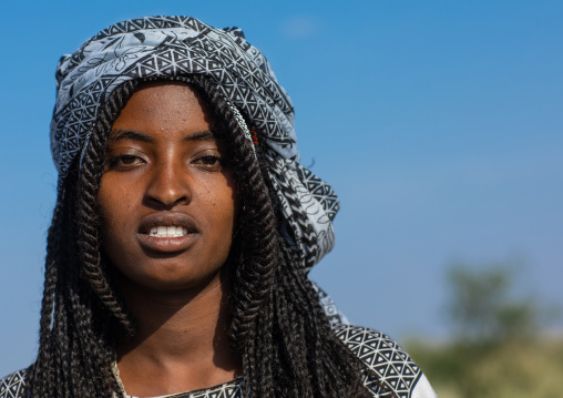 Portrait of a smiling afar woman, Afar region, Mile, Ethiopia