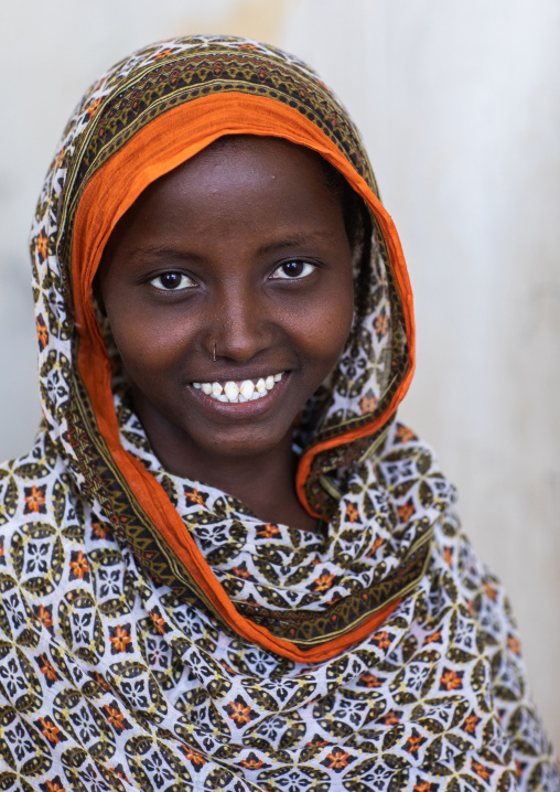 Portrait of a veiled smiling afar tribe girl with sharpened teeth, Afar Region, Afambo, Ethiopia
