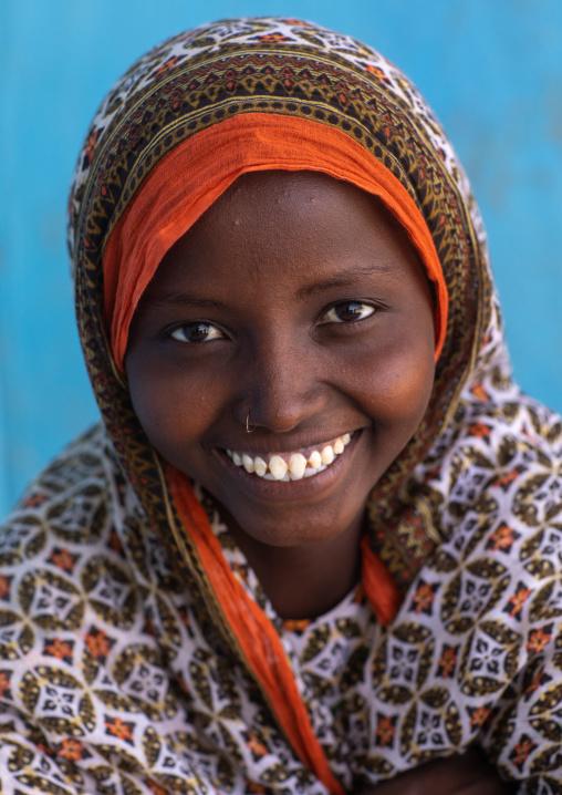 Portrait of a veiled smiling afar tribe girl with sharpened teeth, Afar Region, Afambo, Ethiopia