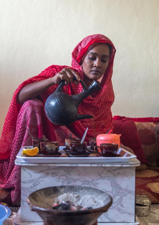 Ethiopian woman serving traditional coffee, Afar Region, Assayta, Ethiopia