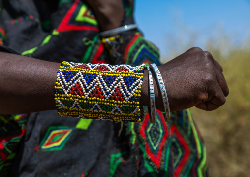 Portrait of an issa tribe woman with a beaded bracelet, Afar Region, Gewane, Ethiopia