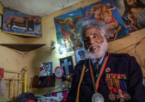 Veteran from the italo-ethiopian war in army uniform inside his home, Addis Abeba region, Addis Ababa, Ethiopia