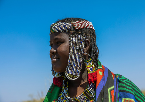 Portrait of an issa tribe woman with a beaded headwear, Afar Region, Gewane, Ethiopia