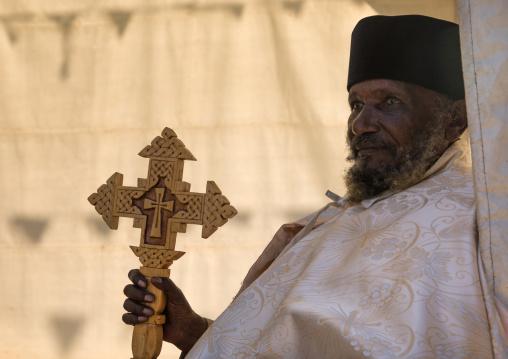 Priest with a cross in Entoto orthodox Maryam Church, Addis Ababa Region, Addis Ababa, Ethiopia