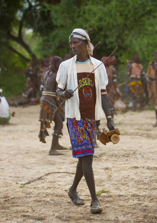 Hamar Tribe Man Holding Headrests At Bull Jumping Ceremony, Turmi, Omo Valley, Ethiopia