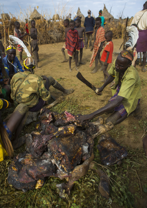 Dassanech Tribe People  Cooking A Cow, Omorate, Omo Valley, Ethiopia
