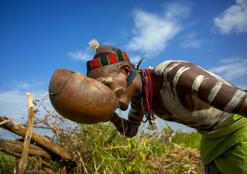 Bashada Tribe Man Drinking In A Calabash, Dimeka, Omo Valley, Ethiopia