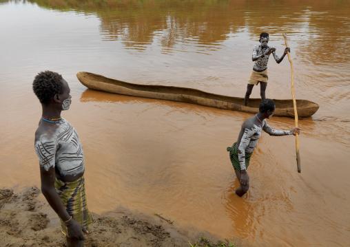 Karo White Painted Chest Karo Men One In A Pirogue On Omo River Holding Pole Ethiopia