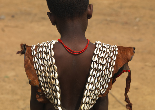Back of a young tsemay girl top cloth made of cowry shells and skin, Omo valley, Ethiopia