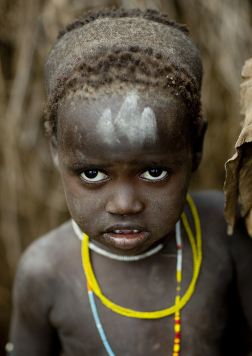 Young Mursi Child With Traditional Hairstyle And Beaded Necklace Ethiopia