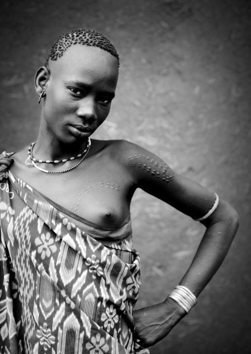 Black And White Portrait Of Miss Bichai, Young Bodi Tribe Woman With Traditional Hairstyle And Scarifications, Hana Mursi, Omo Valley, Ethiopia