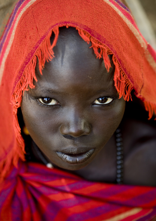 Portrait Of A Young Bodi Tribe Woman With Red Scarf, Omo Valley, Ethiopia