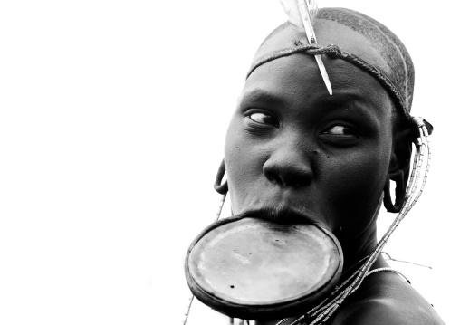 Black And White Portrait Of A Mursi Tribe Woman With Lip Plate And Enlarged Ears In Mago National Park, Omo Valley, Ethiopia