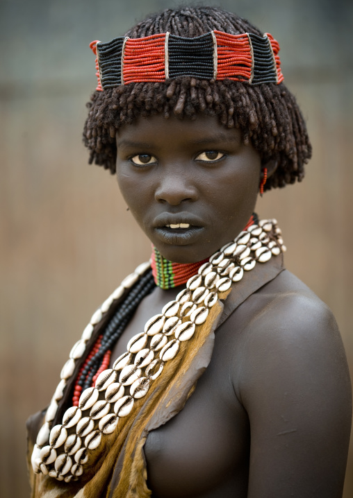 Portrait Of A Hamar Tribe Woman With Headband And Traditional Shell Necklace, Turmi, Omo Valley, Ethiopia