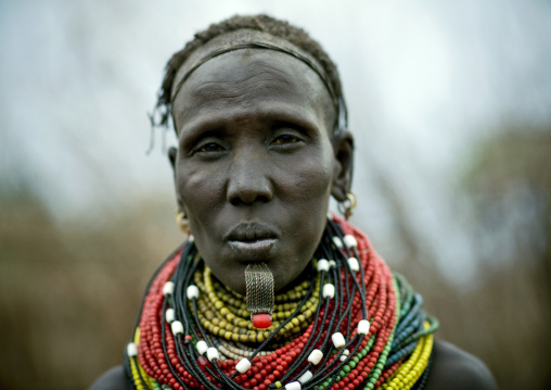 Portrait Of A Senior Nyangatom Tribe Woman Wearing Some Big Beaded Necklaces, Omo Valley, Ethiopia