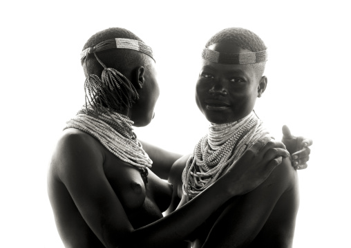 Black And White Portrait Of Two Embraced Karo Tribe Women, Korcho Village, Omo Valley, Ethiopia