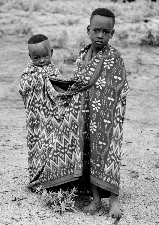 Black And White Portrait Of Karo Tribe Kids Wrapped Up In A Shared Blanket, Korcho Village, Omo Valley, Ethiopia