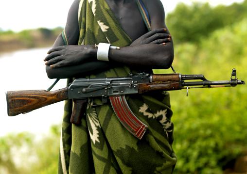 Kalashnikov On The Hip Of A Mursi Tribe Man In Mago National Park, Omo Valley, Ethiopia