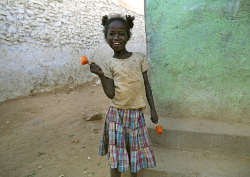 Little Girl Wit Ice Cream In The Street, Harar, Ethiopia