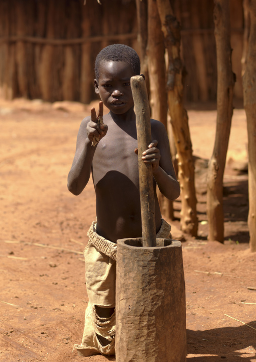 Portrait Of A Konso Tribe Kid Asking Money, Konso, Omo Valley, Ethiopia