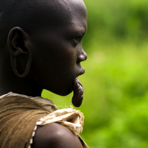 Portrait Of A Young Mursi Tribe Woman With Enlarged Lip In Mago National Park, Omo Valley, Ethiopia