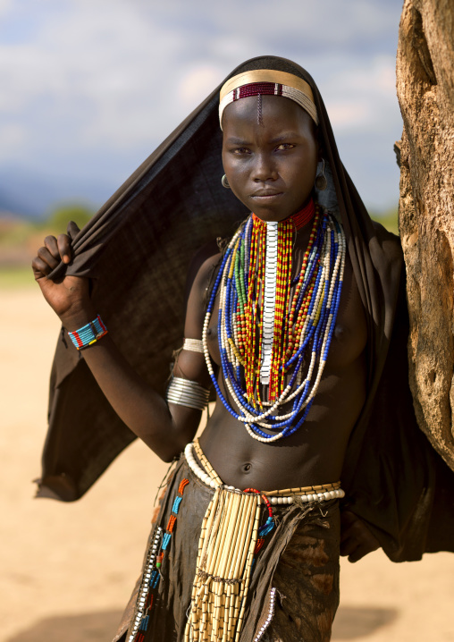 Portrait Of An Erbore Tribe Woman With Black Veil And Colourful Necklaces, Weito, Omo Valley, Ethiopia