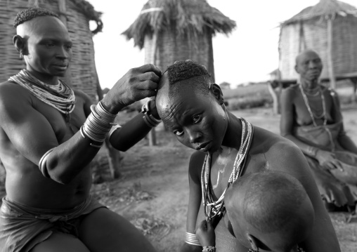 Black And White Picture Of A Karo Tribe Woman Receiving A Haircut, Korcho Village, Omo Valley, Ethiopia