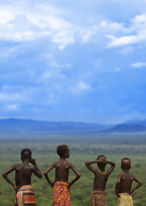 Rear View Of Karo Tribe Kids Looking At The Landscape, Korcho Village, Ethiopia