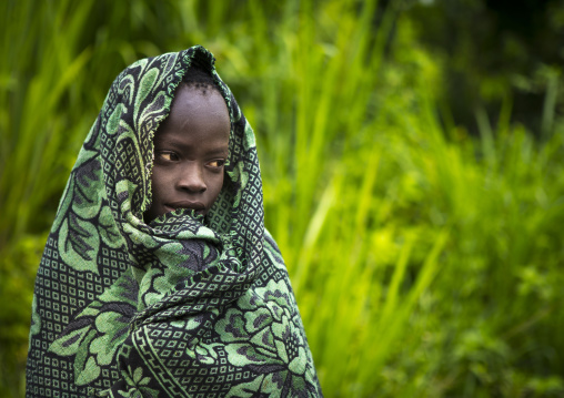 Suri girl in a plantation, Koka, Omo valley, Ethiopia