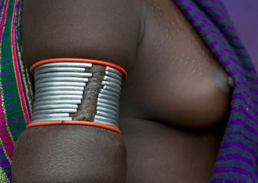 Detail of a bracelet on a Suri tribe woman, Kibish, Omo valley, Ethiopia
