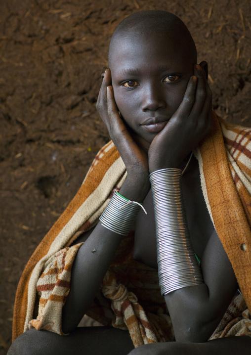 Beautiful Suri tribe woman with impressive bracelets, Kibish, Omo valley, Ethiopia