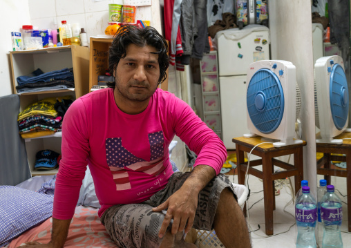 Afghan refugee in a tiny apartment, Special Administrative Region of the People's Republic of China, Hong Kong, China