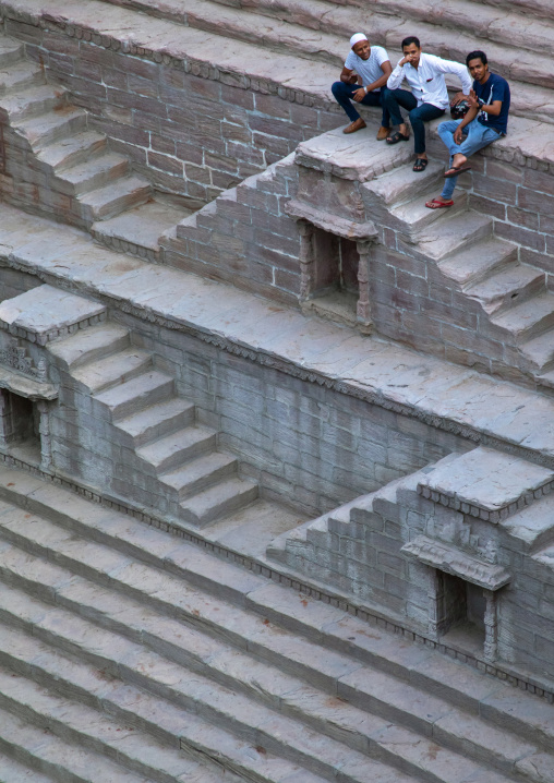 Indian men in toorji ka Jhalra stepwell, Rajasthan, Jodhpur, India