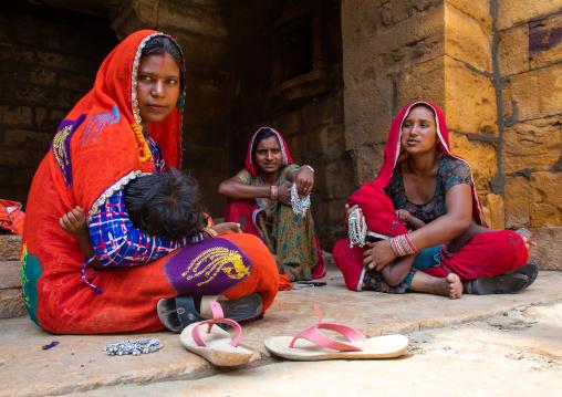 Rajasthani women sit in the street, Rajasthan, Jaisalmer, India