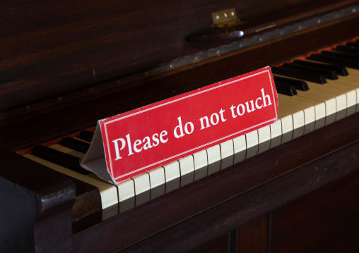 Piano with a sign do not touch in the city palace, Rajasthan, Udaipur, India