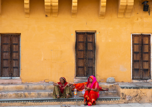 Indian women sit in Amer fort and palace, Rajasthan, Amer, India