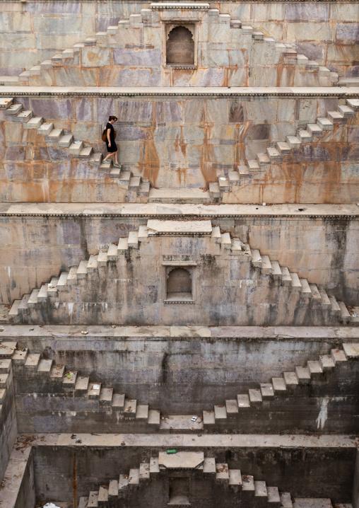 Western tourist in Nagar sagar Kund stepwell, Rajasthan, Bundi, India