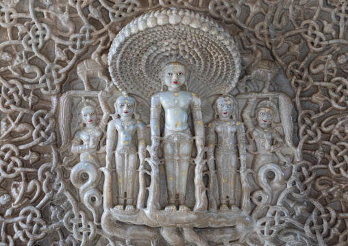Carved idol made of white marble on the wall of Tirthankar jain temple, Rajasthan, Ranakpur, India