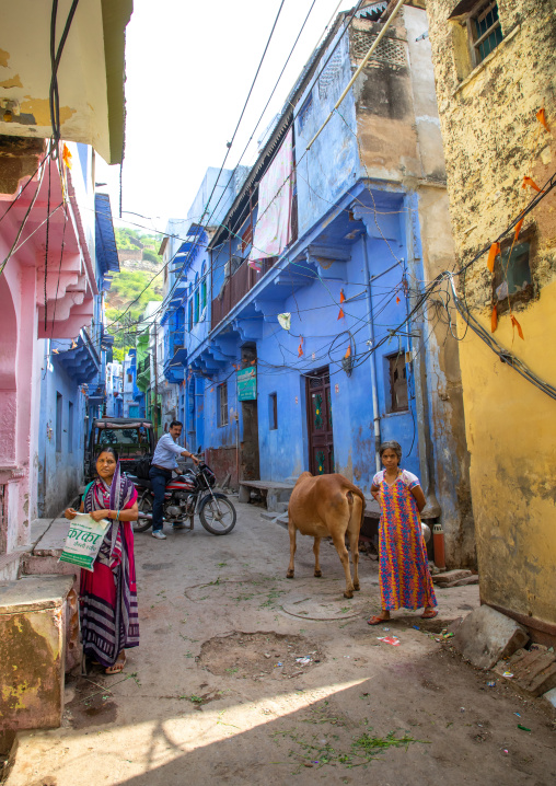 Indian people in front of old blue house of a brahmin, Rajasthan, Bundi, India