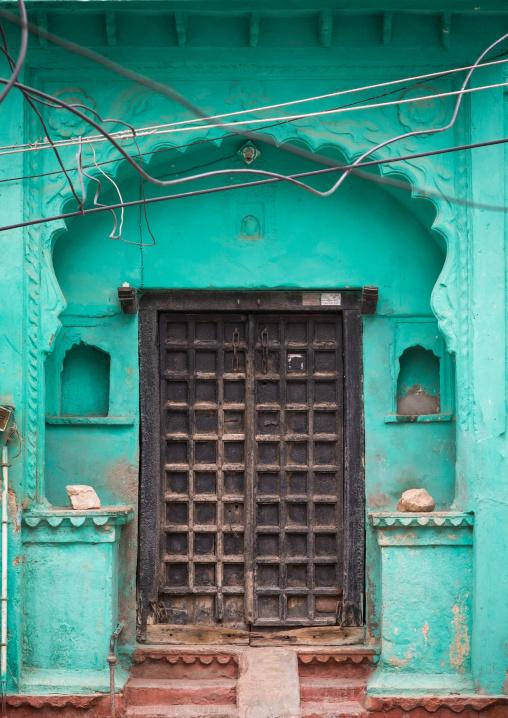 Wooden door of a green haveli, Rajasthan, Bundi, India