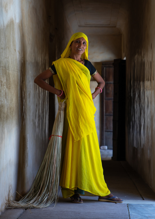 Portrait of a rajasthani woman in traditional yellow sari in nahargarh fort, Rajasthan, Amer, India
