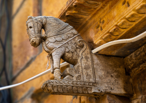 Indian wooden horse at the entrance of a house, Rajasthan, Jaisalmer, India