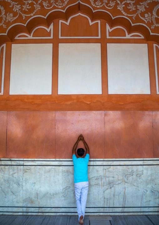 Indian man praying in a temple, Rajasthan, Jaipur, India