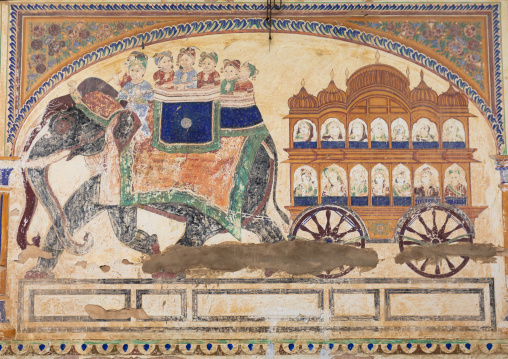 Wall paintings depicting indian people on an elephant on an old haveli, Rajasthan, Nawalgarh, India