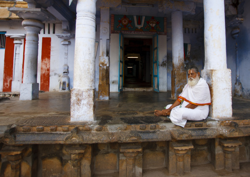 Old Priest With A White Beard Meditating At The Entrance Of The Sri Ranganathaswamy Temple, Trichy, India