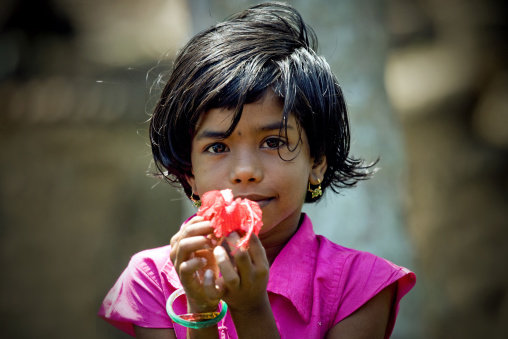 Alleppey Kid In Kerala Holding A Flower In Her Hands, India