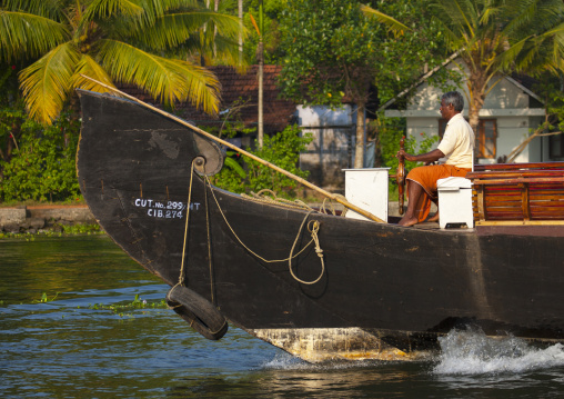Men At The Helm Of A Houseboat On Kerala Backwaters, Alleppey, India