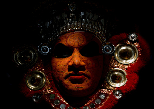 Portrait Of A Theyyam Artist With Traditional Makeup On His Face Dressed For The Ritual, Thalassery, India