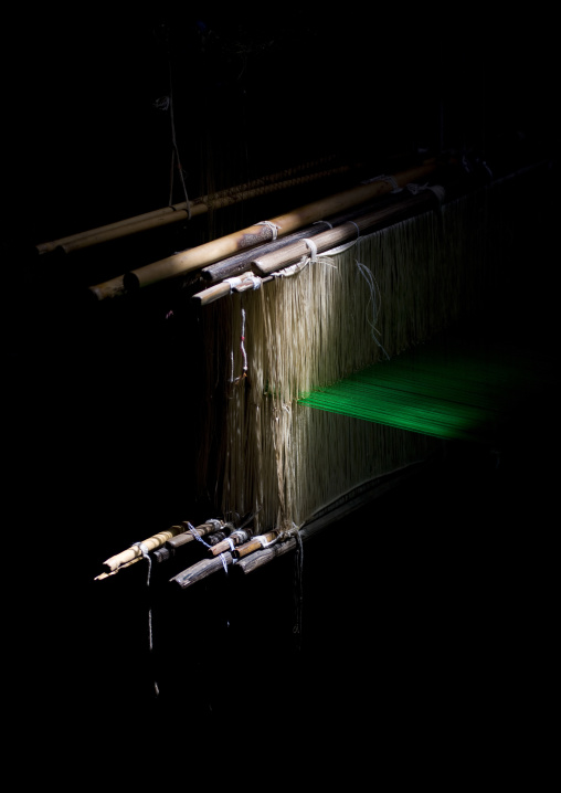 Traditional Wooden Weaving Loom In The Shadows In Motion With Green Yarn, Kumbakonam, India